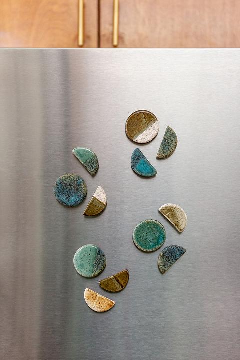 Ceramic magnets on a refrigerator door